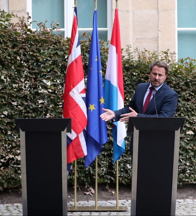 Xavier Bettel was accused of egging on the mob as he stood by the empty lectern