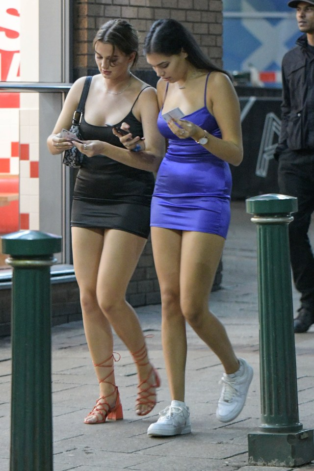 Two pals check their phones as they head out for freshers' week in Birmingham