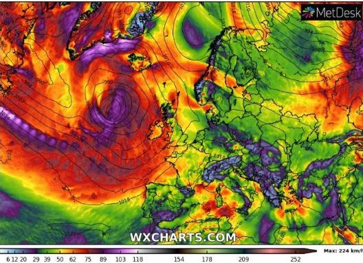 Hurricane Humberto's remnants, the purple patch of low pressure on the left, can be seen battering Britain in this weather chart for Monday evening
