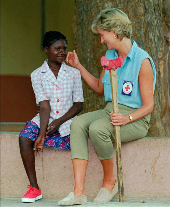The Princess of Wales speaks with then 13-year-old Sandra Thijica, who lost her leg to a land-mine in 1994