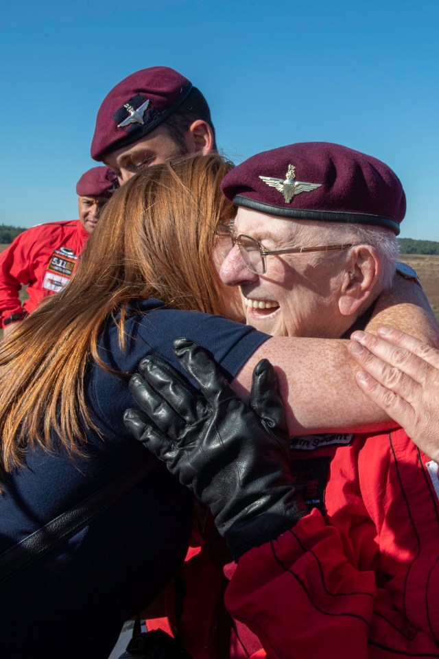 Scottish veteran Sandy Cortmann gets a hug from his carer Arlene Campbell after touching down