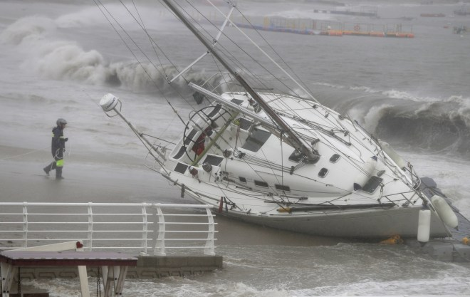 A stranded yacht is beached by strong tides in Ulsan, South Korea