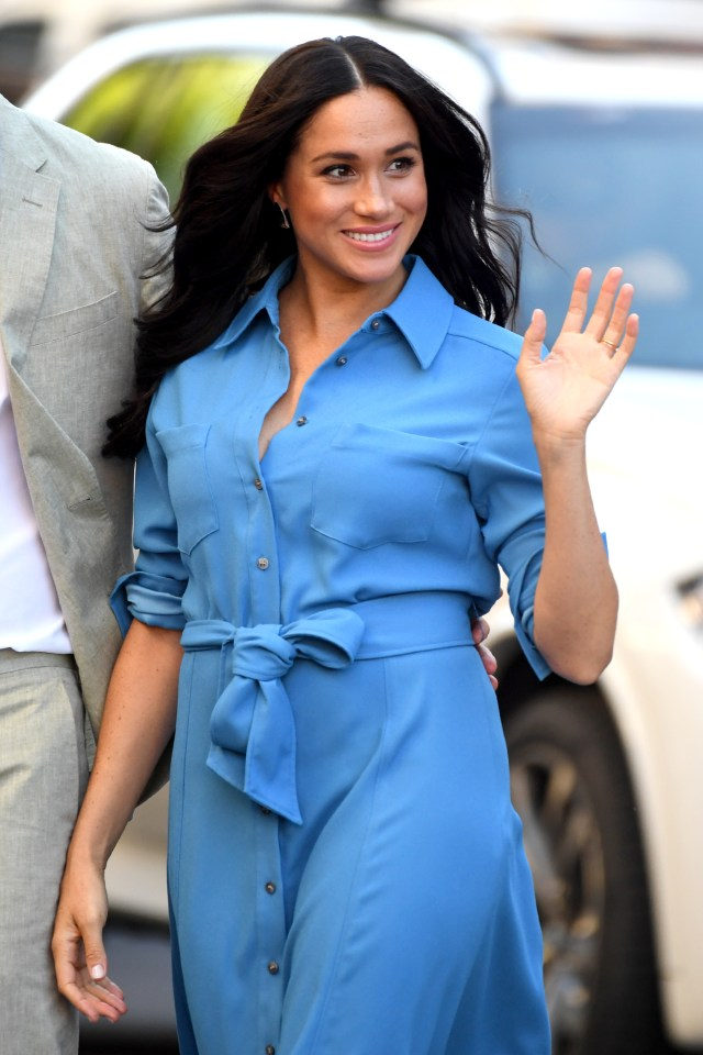 Meghan looked stunning in a cobalt blue wrap dress