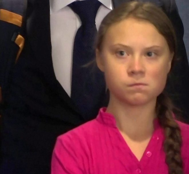 Greta's expression changed into an ice cold glare as Trump made an unexpected entrance