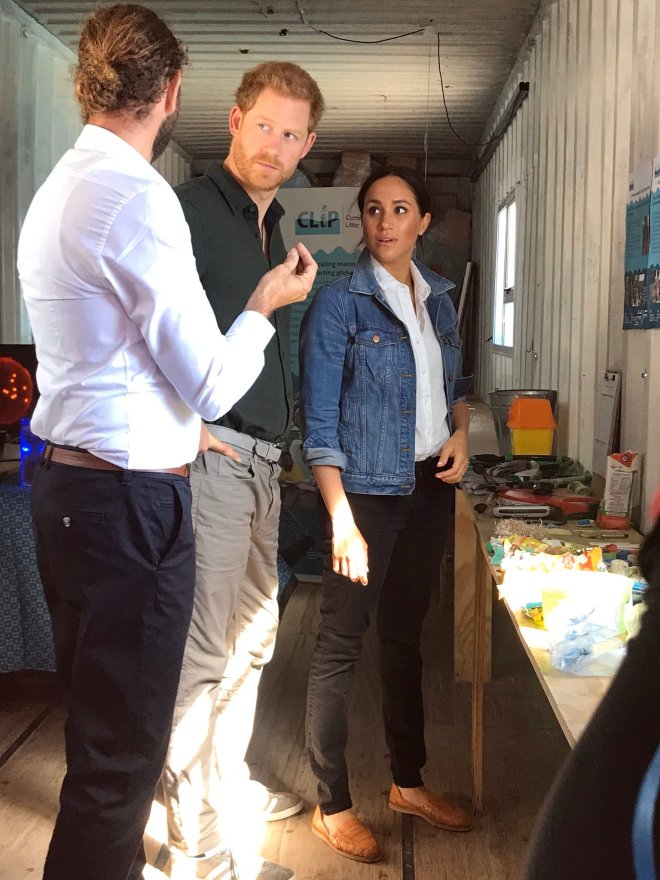 Both Harry and Meghan are taught about the numerous projects working to support the local community