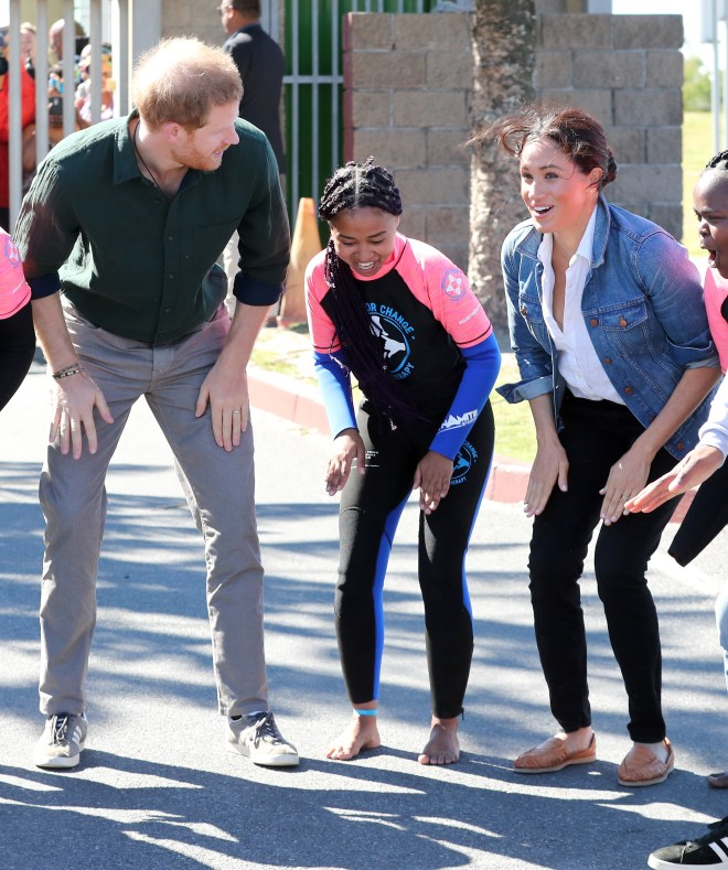 Meghan and Harry joined a dancing circle as they visited the charity on the beach today