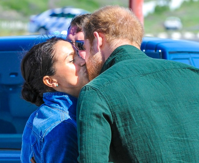 Meghan and Harry kiss as they leave for separate events yesterday