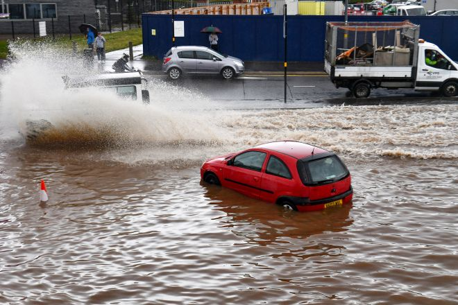 A stranded car sits on a flooded road in Birmingham city centre on Tuesday