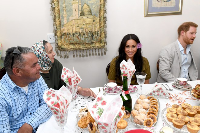 Meghan sits down to have afternoon tea with a local family