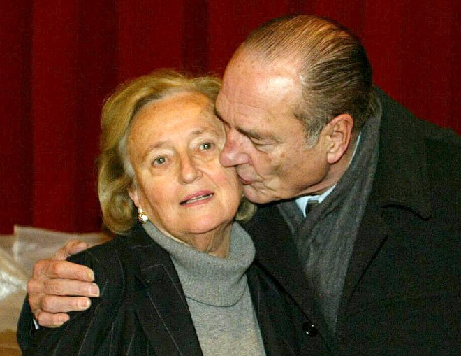 Chirac kisses his wife Bernadette after her victory in regional polls in 2014
