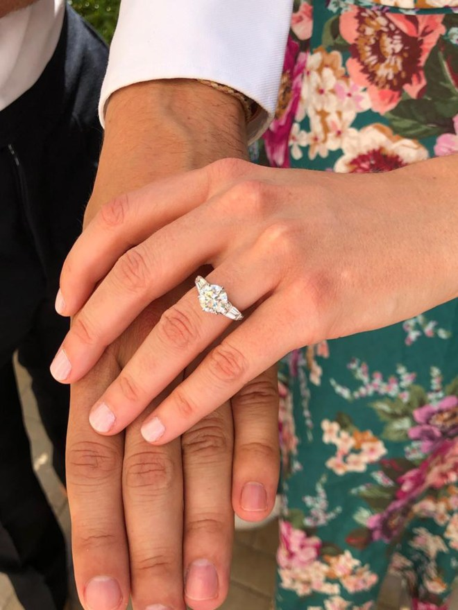 The couple show off the gorgeous engagement ring
