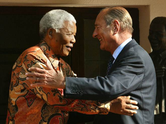 Chirac hugs Nelson Mandela after their meeting in Johannesburg in 2002