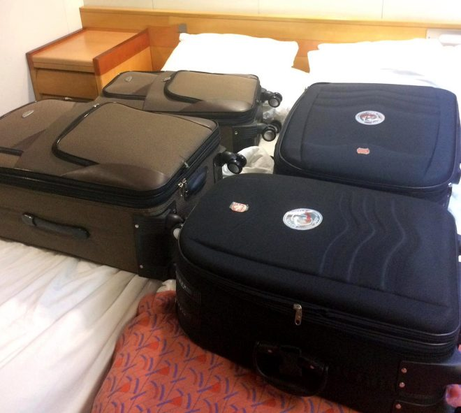 Police pictures show the suit cases being taken apart to show the hidden Cocaine in the Clarke's cabin