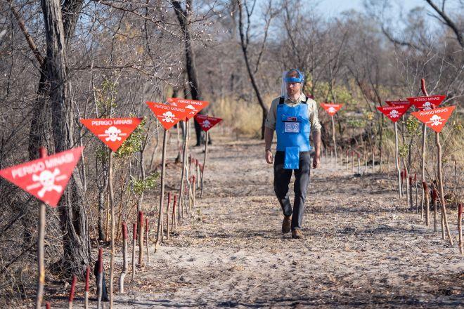 Prince Harry walks through a minefield in Dirico, Angola