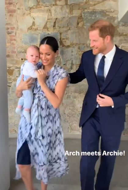 Meghan Markle holds baby Archie with Prince Harry by their side
