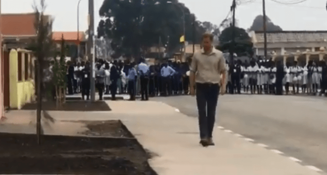 Prince Harry walks down a street that was once a landmine his mother Princess Diana visited