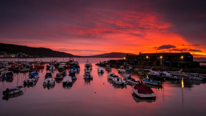 A red sky covered Lyme Regis harbour