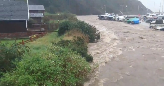 This image shows flooding at Laxey Harbour on the Isle of Man after torrential storms