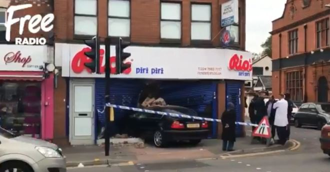 This is the scene of the crash from yesterday morning after the BMW ploughed into the chicken shop