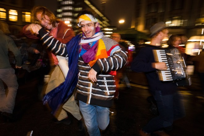 Eco-warriors dance as night falls after the first day of Extinction Rebellion October protests