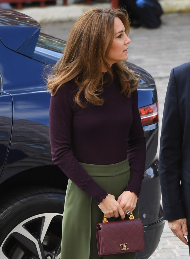 The mum-of-three wore autumn colours for the visit