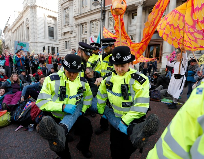 Climate protesters of the group Extinction Rebellion are arrested by police in Whitehall