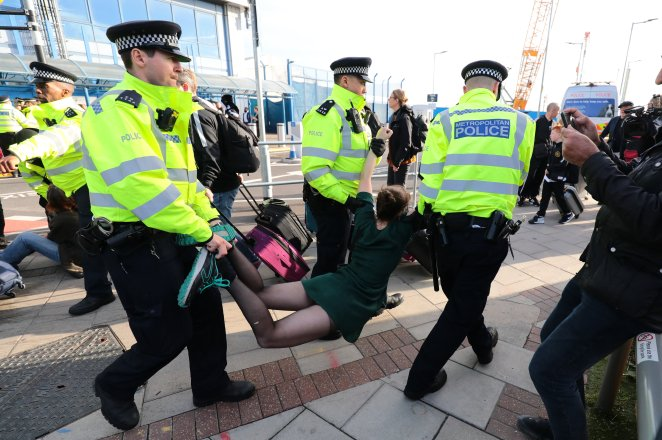 Police were seen dragging away protesters from the airport entrance