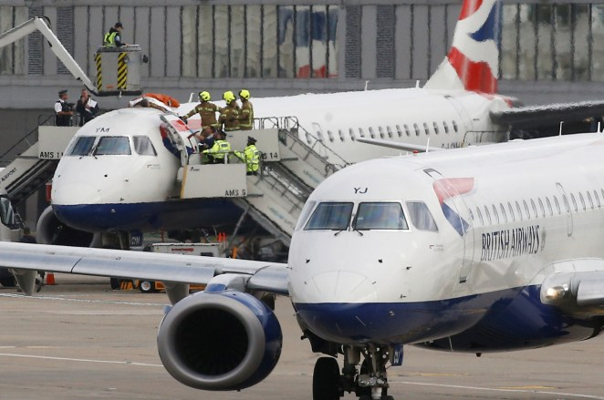 The protester glued himself to the top of a BA Embraer 190 jet