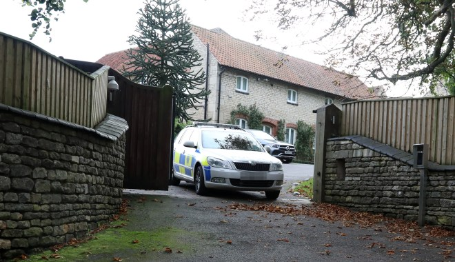 A police car leaves the home of Jamie and Rebekah Vardy