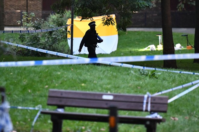 A forensic tent can be seen at the scene where an 18-year-old was stabbed last night