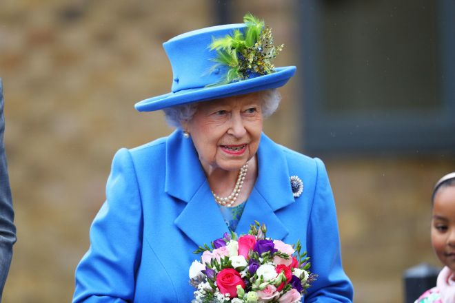 The monarch wore a cornflower blue dress and coat from designer Angela Kelly, alongside a matching hat