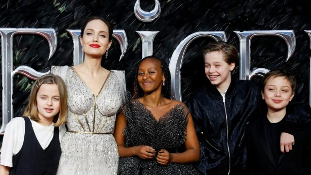 Angelina Jolie and kids posing at the Maleficent premiere