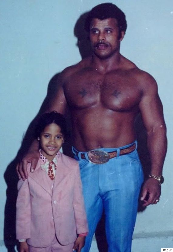 The Rock poses with his father Rocky as a child