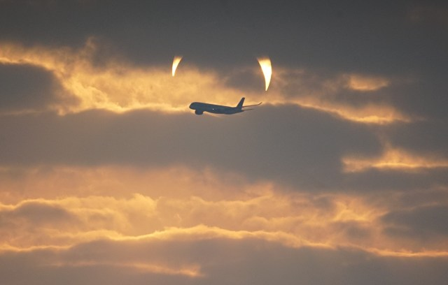 The photographer also captured the crescent in the sky behind the clouds