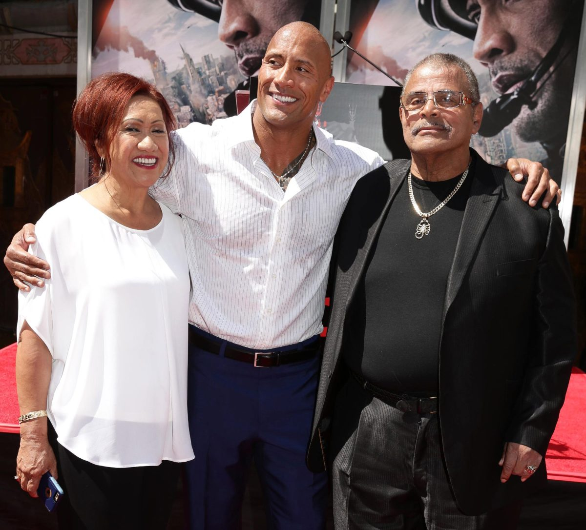 The Rock (center) with his mother Ata and his father Rocky, became one of the greatest fighters in history and a great Hollywood star