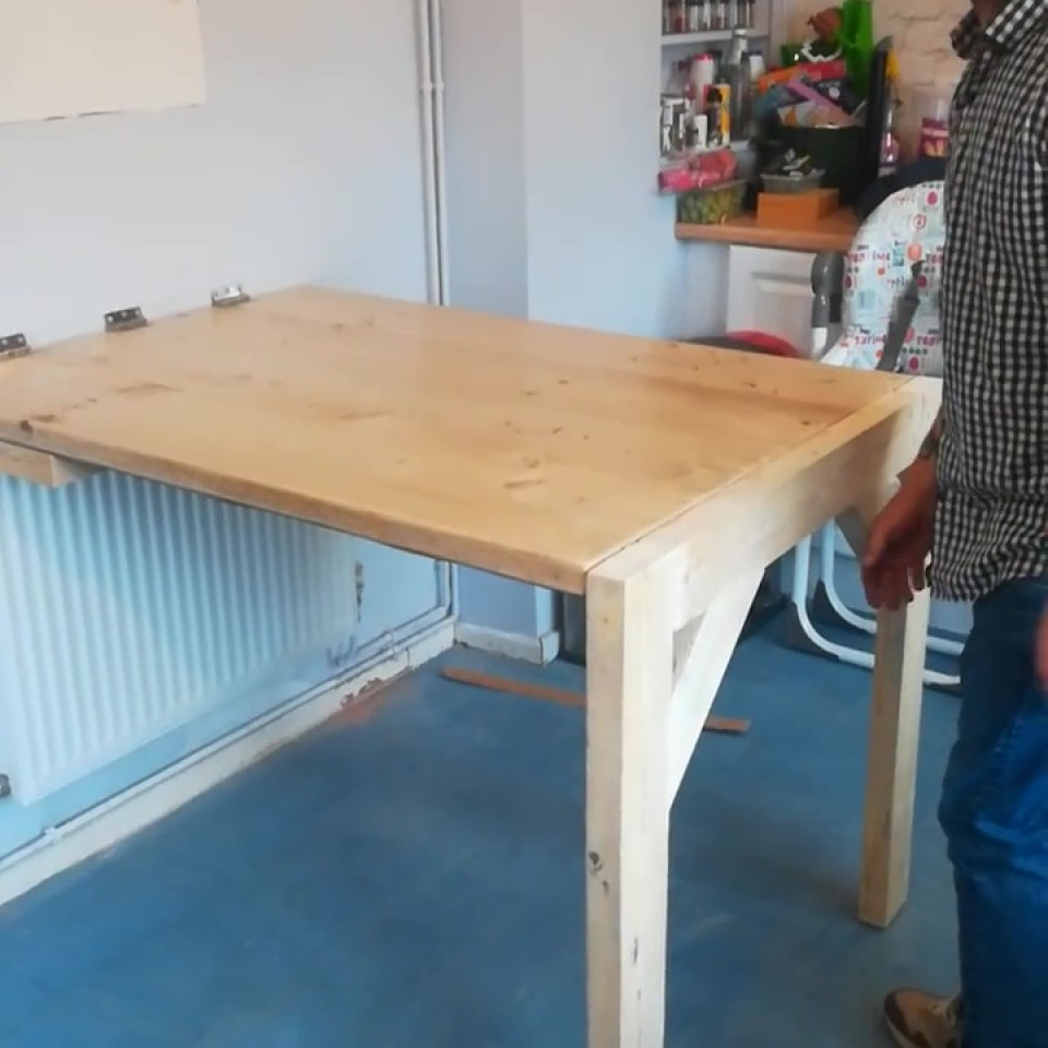 Husband praised for making £37 dining table which folds into wall after wife moans their old one takes up too much space