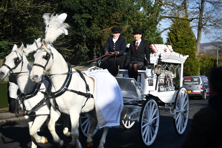 White horses carry the coffins