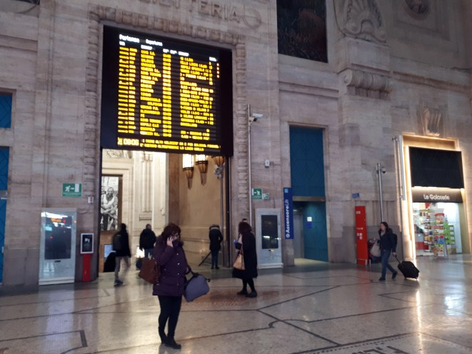 Milan's virtually deserted Central Railway Station during morning rush hour