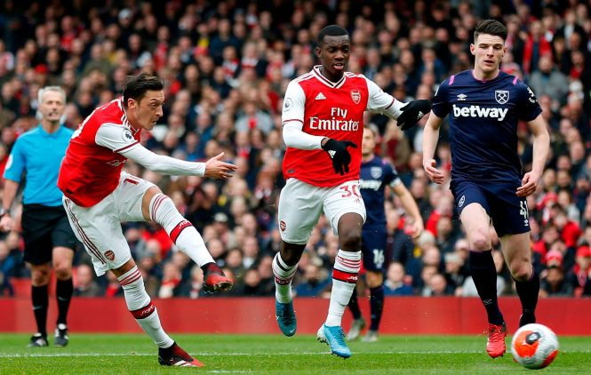 Arsenal midfielder Mesut Ozil fails with this effort against lowly West Ham at the Emirates