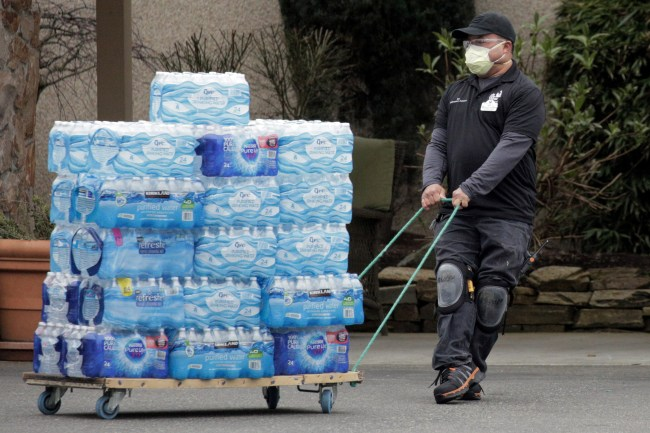 A worker transports donations of bottled water from Life Community Church in Washington