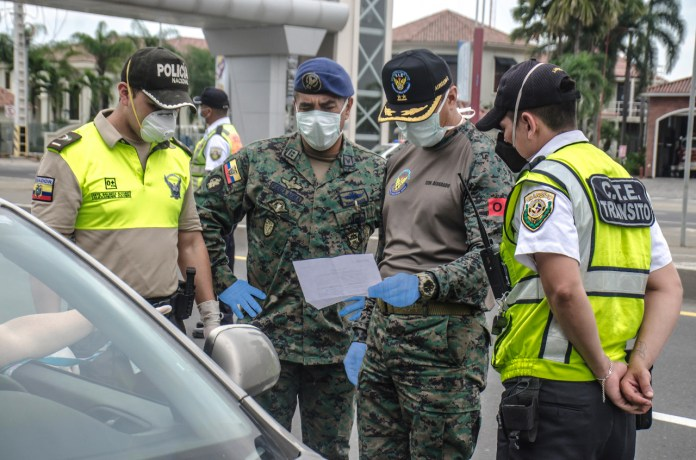 Ecuadorian army troops check drivers' documents in Guayaquil on March 18