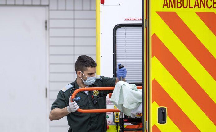 A doctor wearing a mask amid the coronavirus pandemic seizing the UK