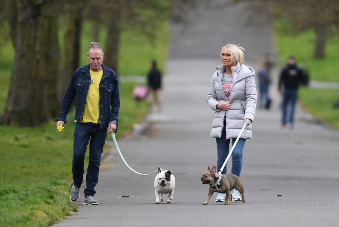 The pair were spotted escaping the lock to take their dogs for a walk in Manchester