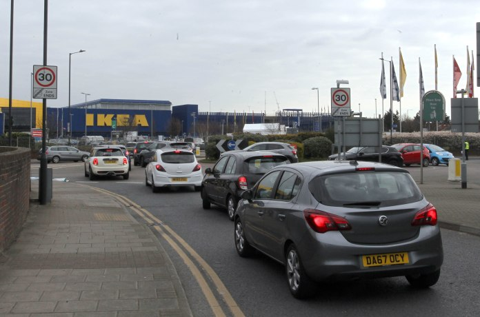 NHS staff line up in their car in an Ikea car park in north west London before coronavirus testing