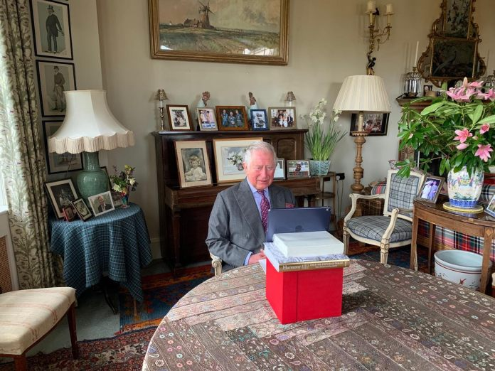 Prince Charles was surrounded by photographs of his family during his speech