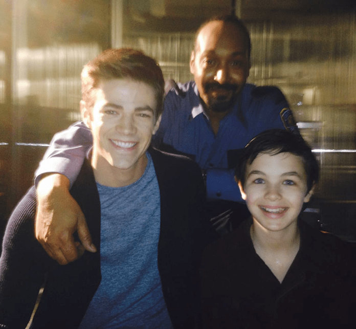 Actor Logan Williams, right, tragically died on Friday night as co-star Grant Gustin paid tribute with a picture of them along with fellow Flash costar Jesse L. Martin.