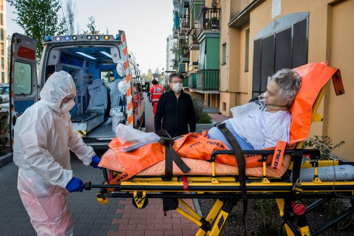 Coronavirus suspect is transported to Milan hospital yesterday