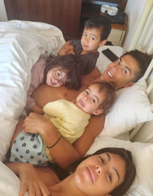 Cristiano Ronaldo cuddles his kids in bed with girlfriend Georgina  Rodriguez as they enjoy family time