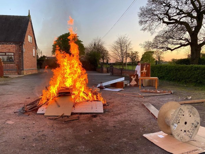 He posted this image showing him burning old furniture with the caption: 'Little spring clean'