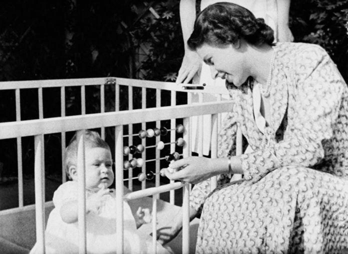 Queen Elizabeth II with her baby Prince Charles in Windlesham Moor Park, country house in Surrey